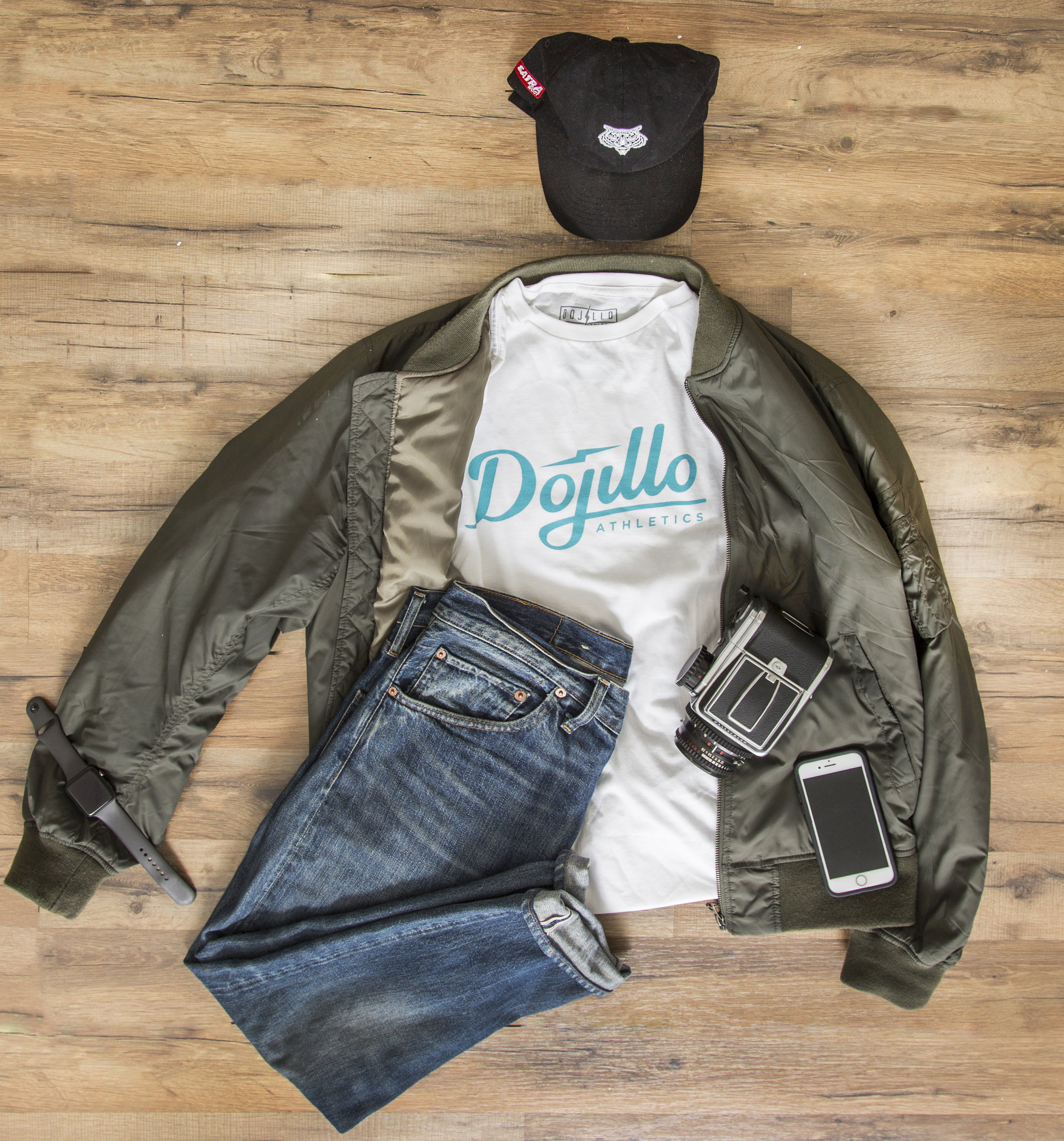 Every Day Carry * Green Bomber * Levi's Selvedge Denim * White DA Script Brand T-Shirt * Hasselblad 500c * I Phone * Apple Watch * A Bad Attitude