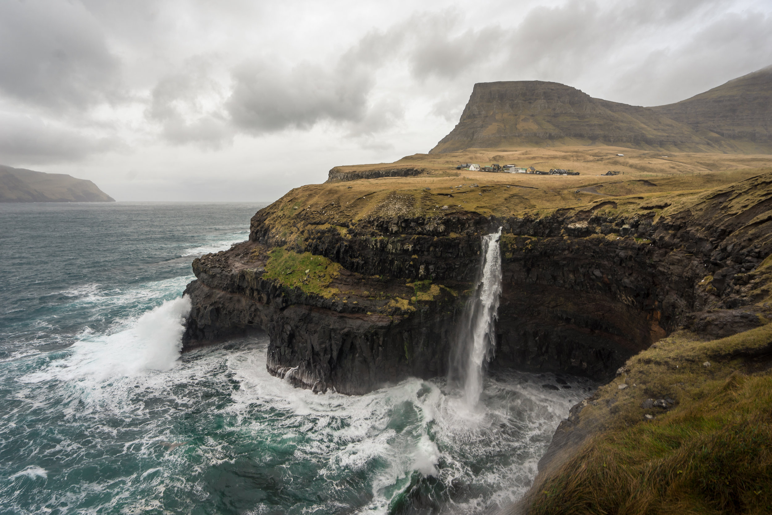 Gasadalur  and Mulafossur Waterfall in the Faroe Islands