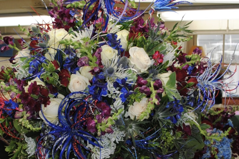 An arrangement created by   Laura Dowling   at The White House in which I painted and glitterd succulents for the 4th of July!