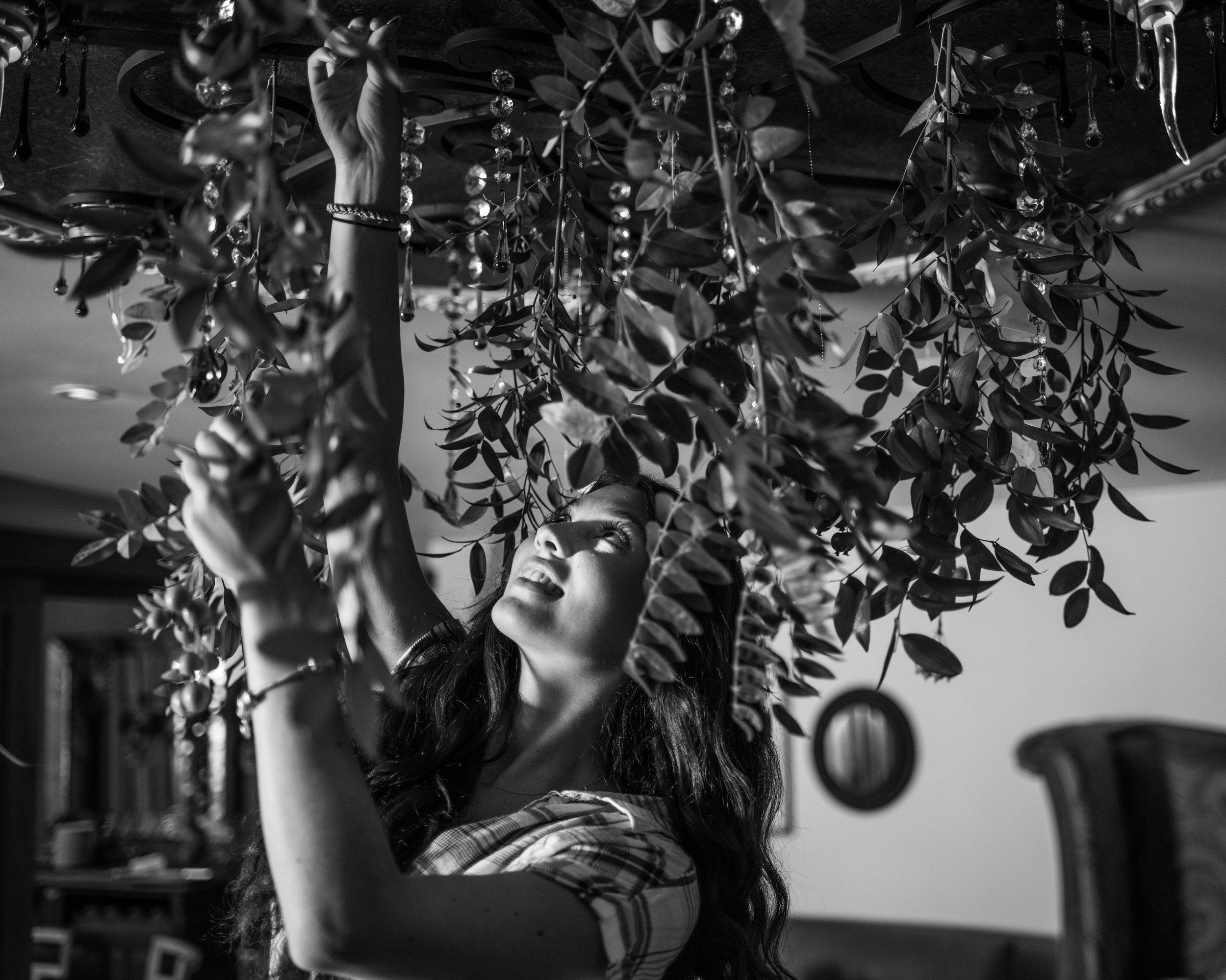 Photo of Sophia adding greenery by   Erin Tetterton