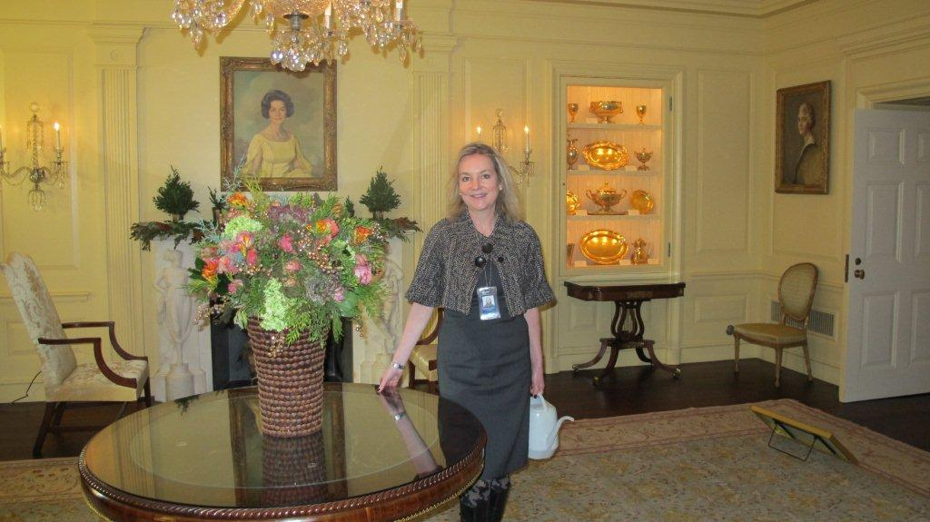 Always watering! Laura in the Vermeil Room with one of her custom container creations. 2011