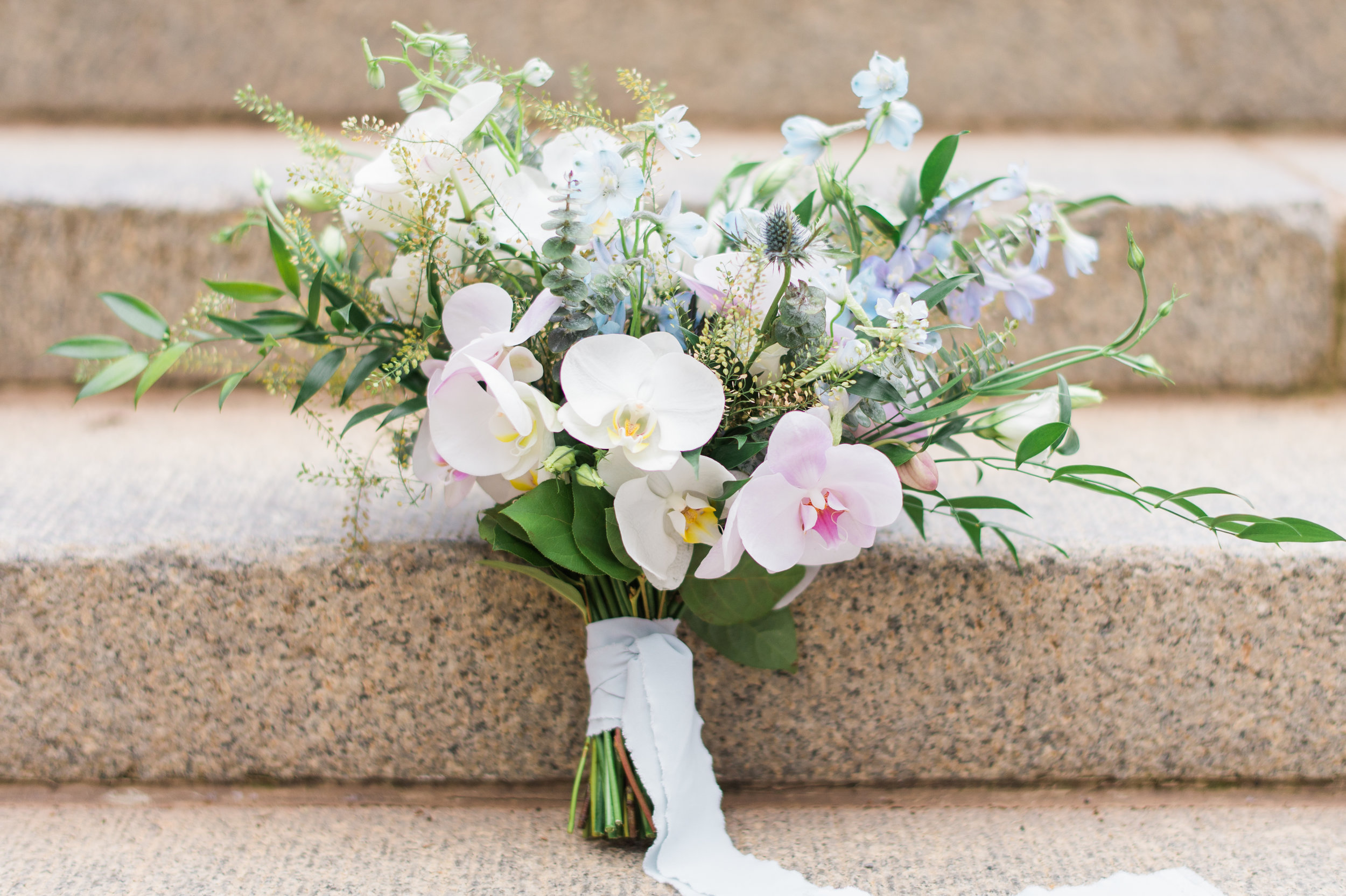 The bouquet. Phalaenopsis in pale pink and white, Delphinium, Thistle, Pennycress, Eucalyptus and local greenery.