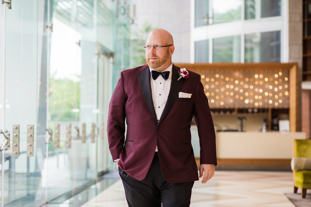 Let's be honest. The groom never gets as much attention as the bride. But I think Brent looks pretty sharp in this bold jacket and Phalaenopsis boutonniere.