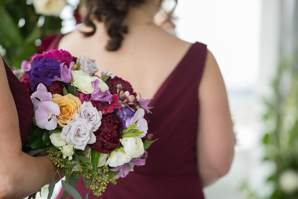 Bridesmaids and bouquets of Garden Roses, Peonies, Phalaenopsis, Clematis vine and greenery.