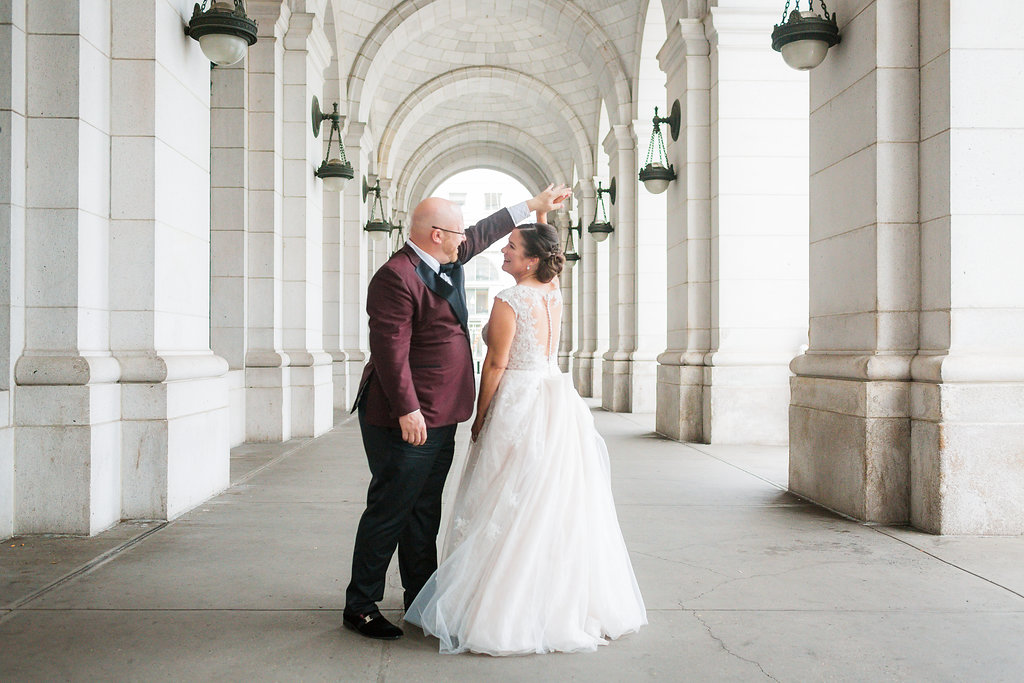 The bride and groom taking a spin at Washington's historic Union Station.