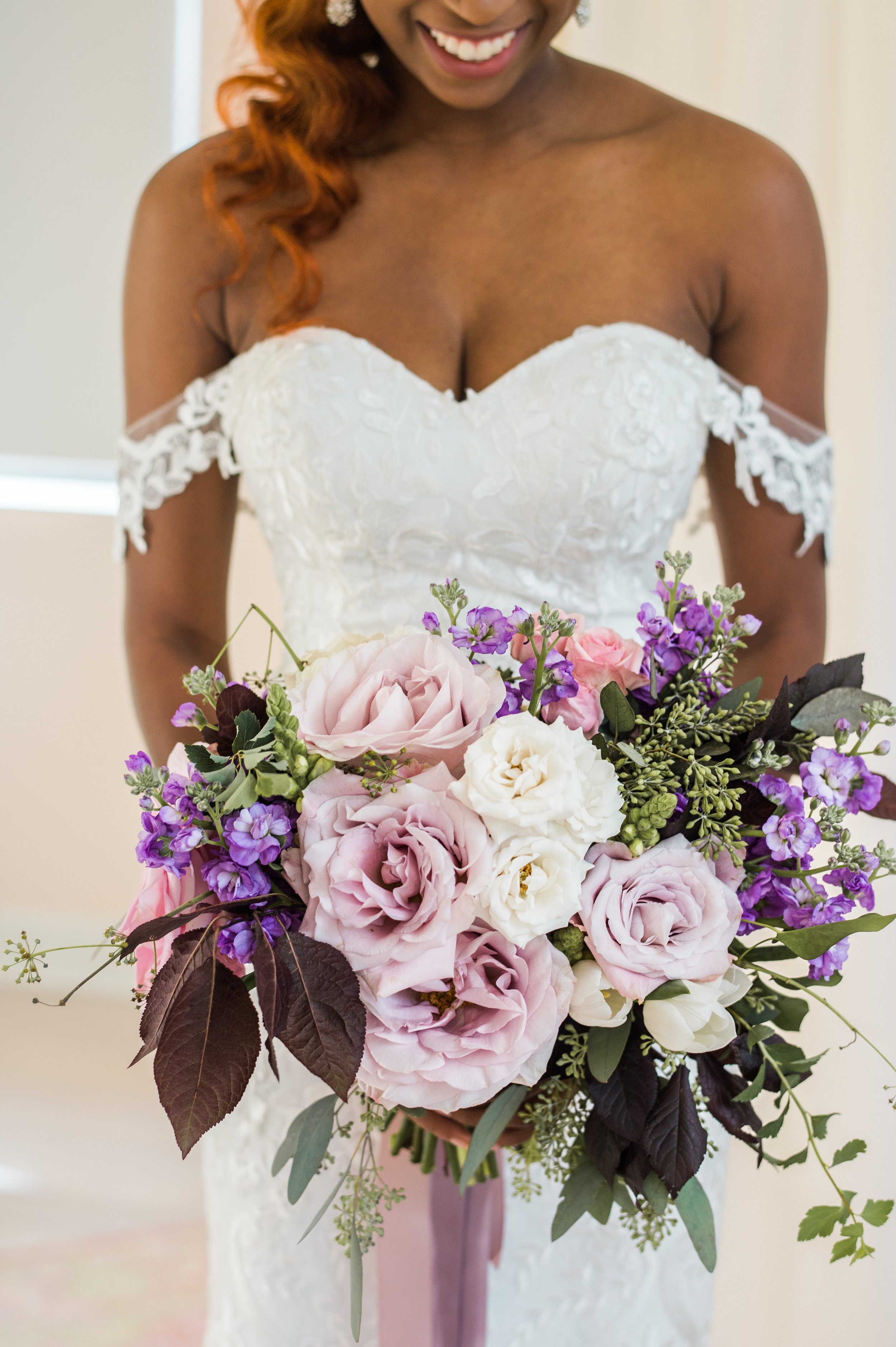 Lavender and violet flowers in every hue paired with greenery making the perfect transition to fall.