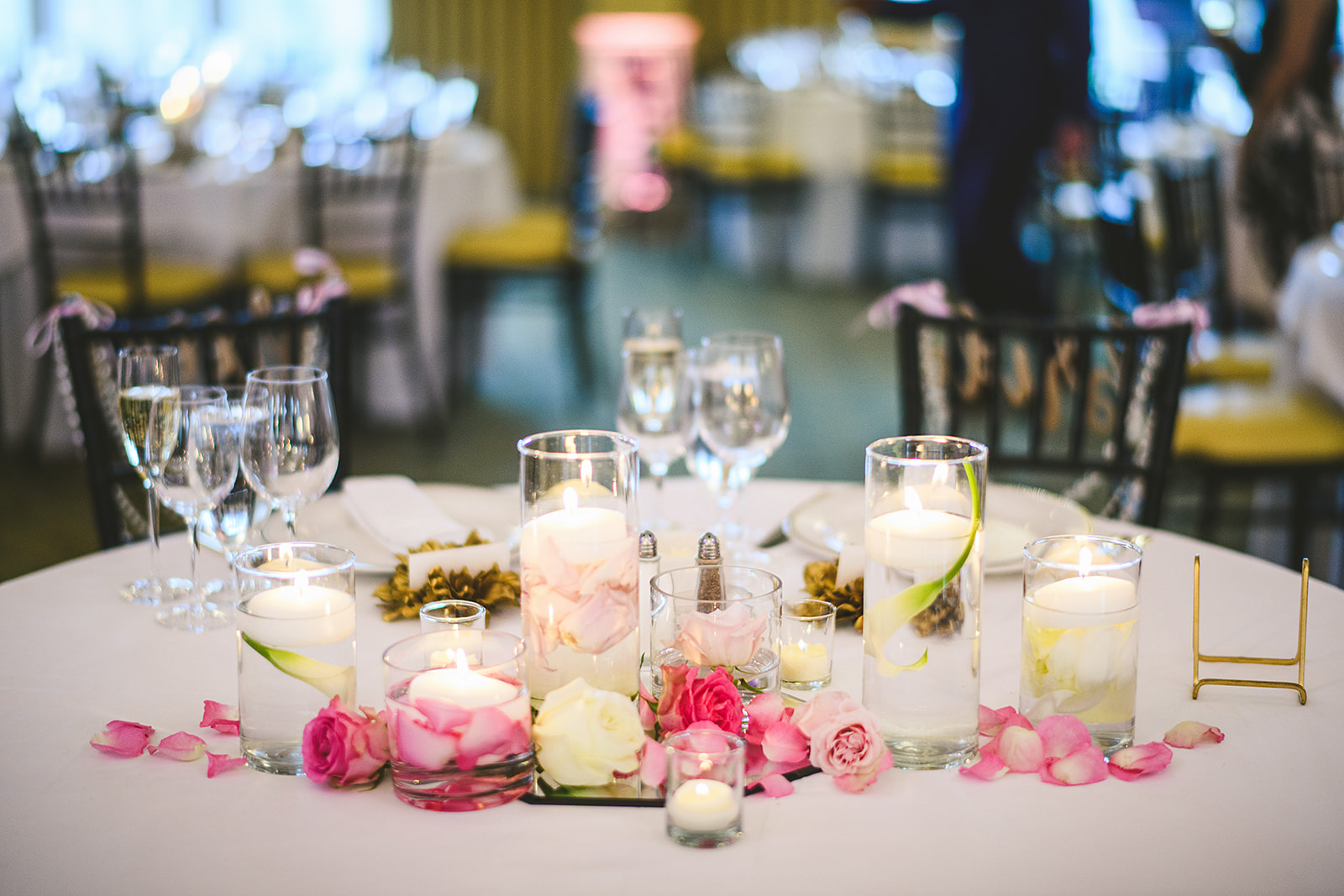 Atelier Ashley Flowers + Sam Hurd Photography + Washington Golf and Country Club + Diamond and Pearl Wedding + sweetheart table + floating candles + rose petals