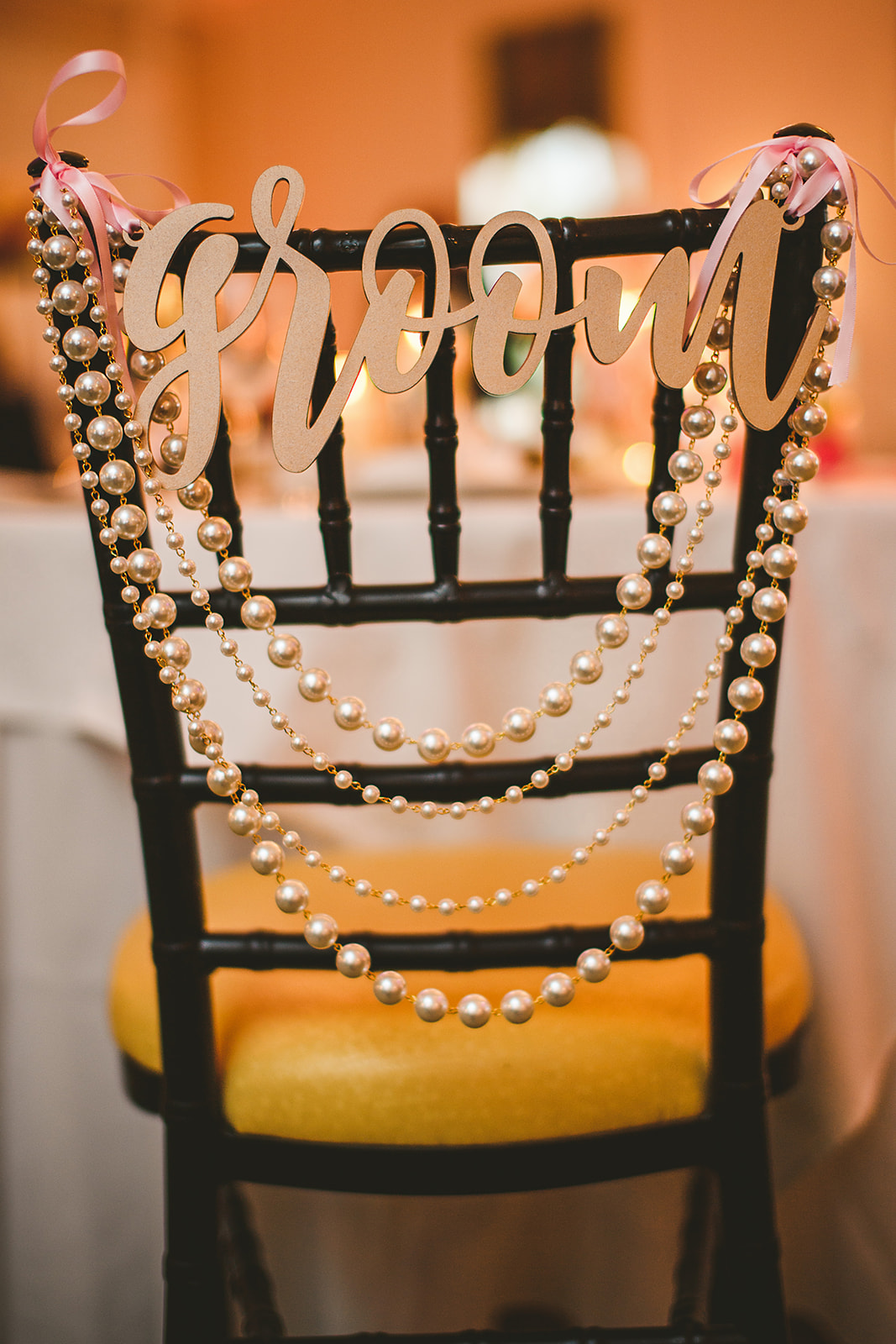 Atelier Ashley Flowers + Sam Hurd Photography + Washington Golf and Country Club + Diamond and Pearl Wedding + chair decor + bride and groom chair
