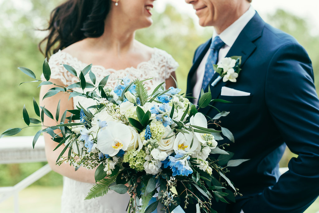 Danielle's bouquet was a wild and organic spring mix of roses, blue delphinium, hyacinth, white stock, orchids and a variety of greenery. Her bouquet was finished with blue and white streaming ribbons.