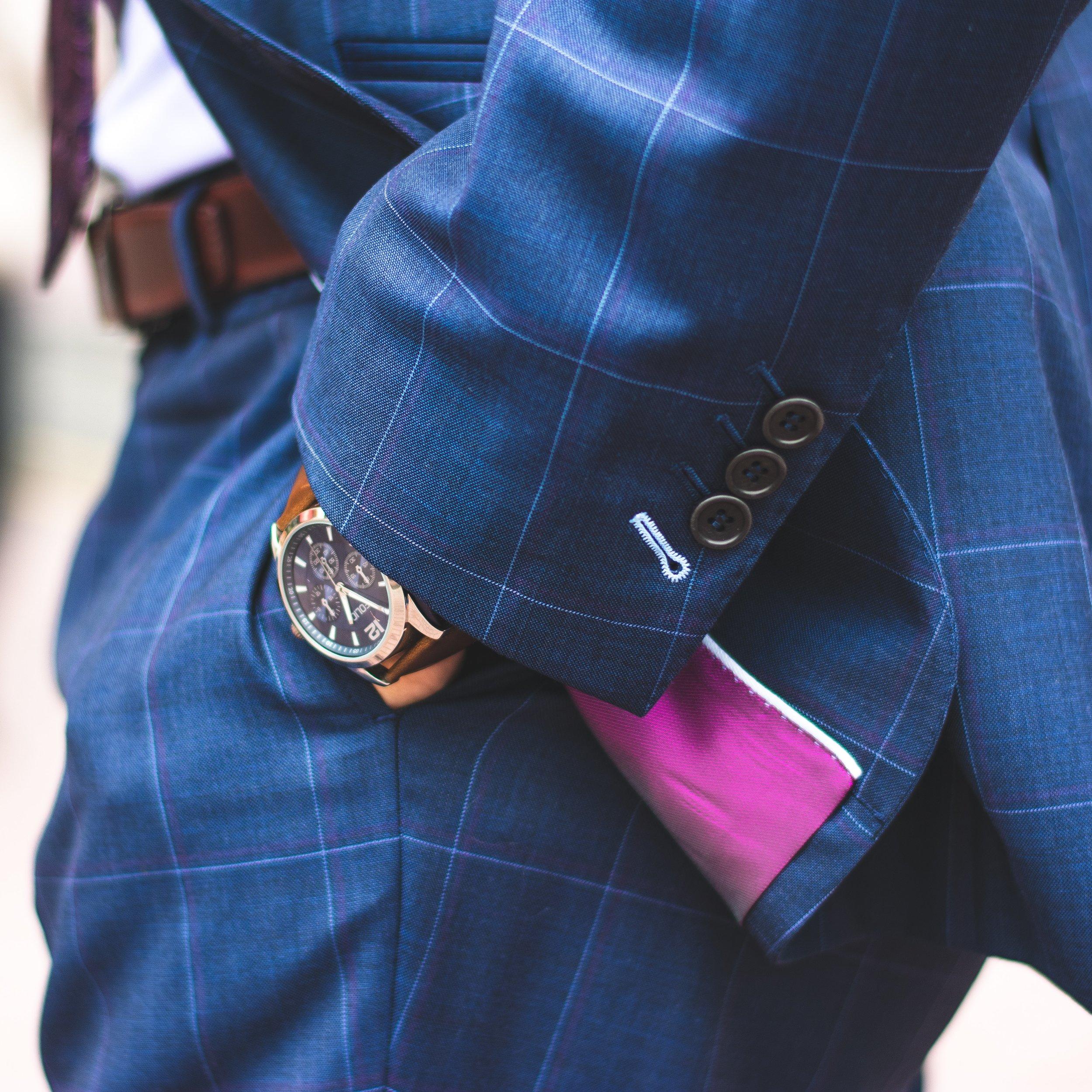businessman-buttons-close-up-2254119.jpg
