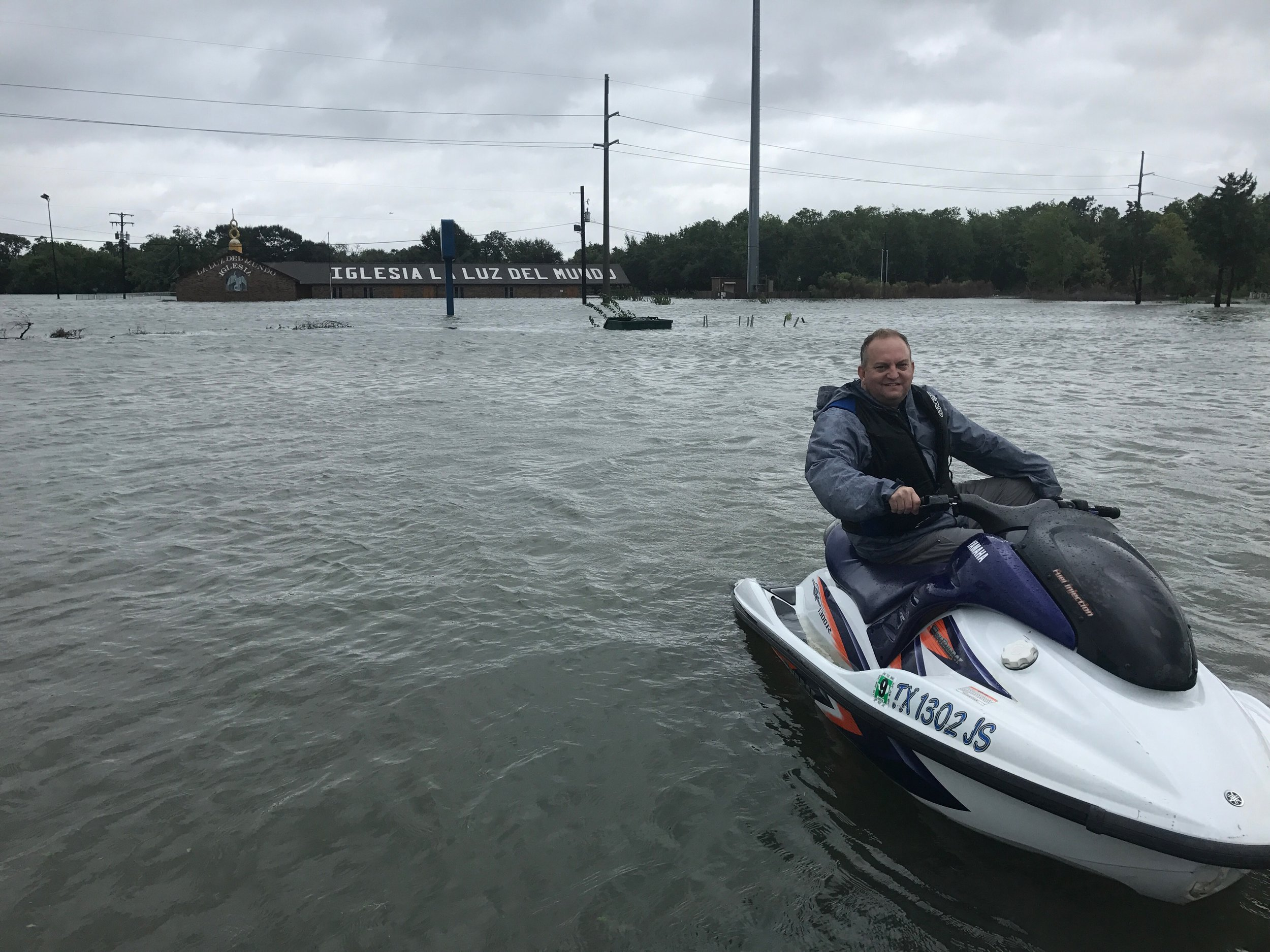Gary Miars, riding a wave runner during rescues in Port Arthur, Texas.