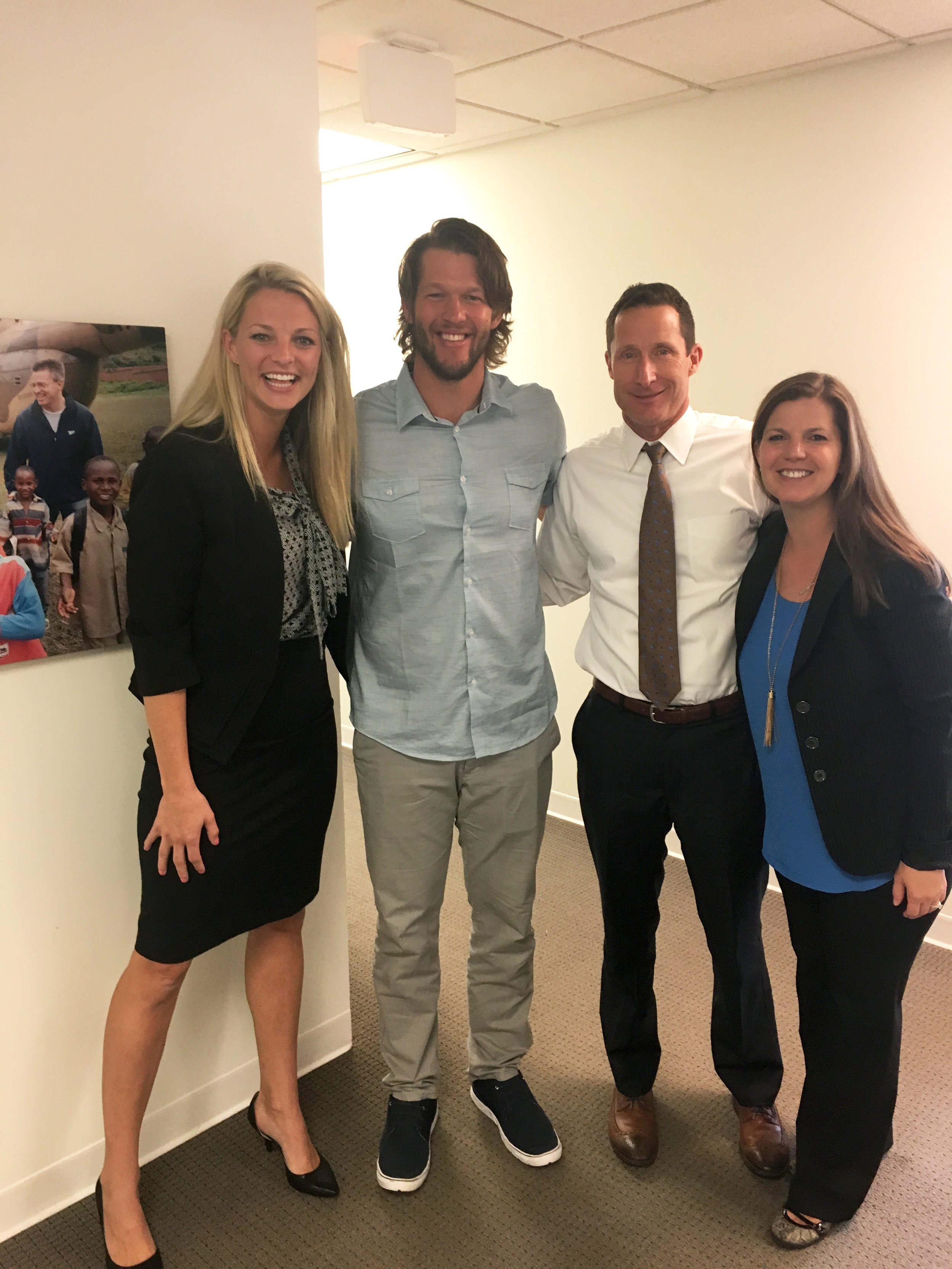 Clayton Kershaw pictured with Mallory, Sean Litton (IJM President) and Jaclyn Willert (Dir of Professional Athlete Partners and Programs) when he visited IJM's headquarters in 2017.