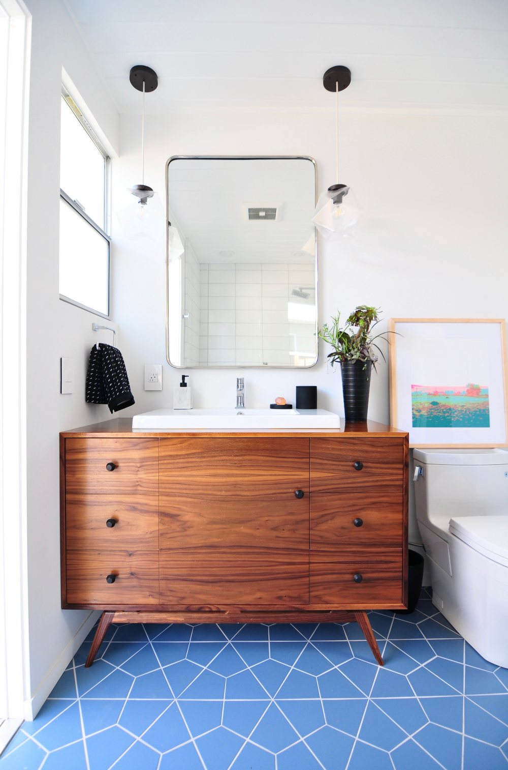 1. Clean Lines - If you're a fan of Mid-Century Modern design you probably appreciate the clean lines and consistency this style offers your home. Paired with natural tones of wood it's the perfect blend of warmth and simplicity.