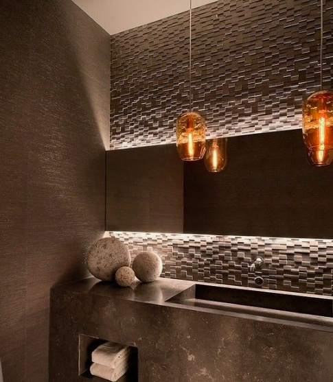 TEXTURED STONE MOSAIC - We love texture in a contemporary home, especially in the Powder Room!Image by Home Bunch