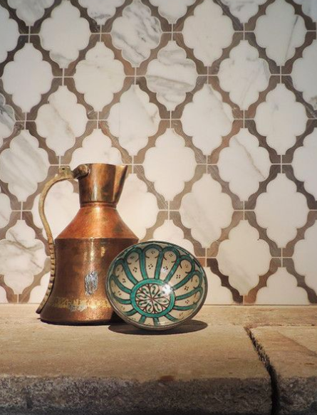 ARABESQUE MOSAIC - A new spin on a very old moroccan shape - the arabesque. Whether you use it as a feature wall in a powder room or maybe installed on an entry way floor, you can't go wrong with a classic arabesque in a modern moroccan home.Image by Pinterest