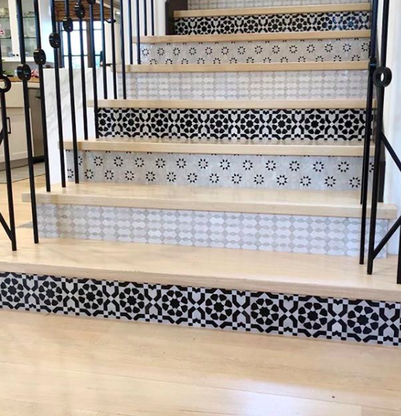 PATTERNED STAIR RISERS - Now this is how you do pattern! Some clients come to us trying to find a balance between doing something unique in their homes, but also not making a space appear busy or overdone. This might be a perfect compromise! Patterned stair risers definitely have our heart…Image by Famosa Tile