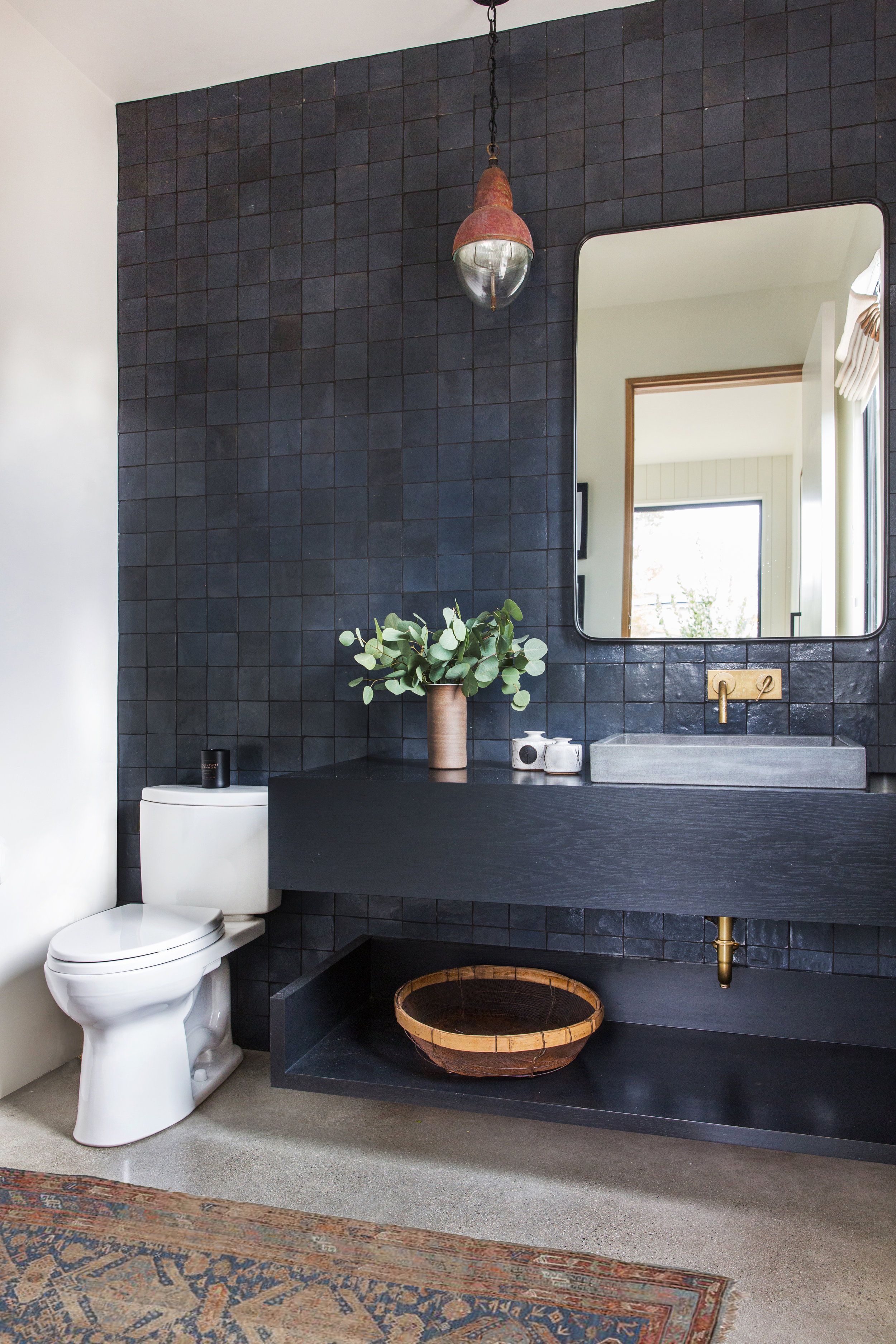 CLASSIC MOROCCAN TILE - Come on, you knew this was coming! You can't have a modern moroccan home without the classic moroccan tile…Amber Interiors kept it moody with this choice of a charcoal color in the powder room vanity wall, and we think it couldn't be more perfect!Image by Amber Interiors