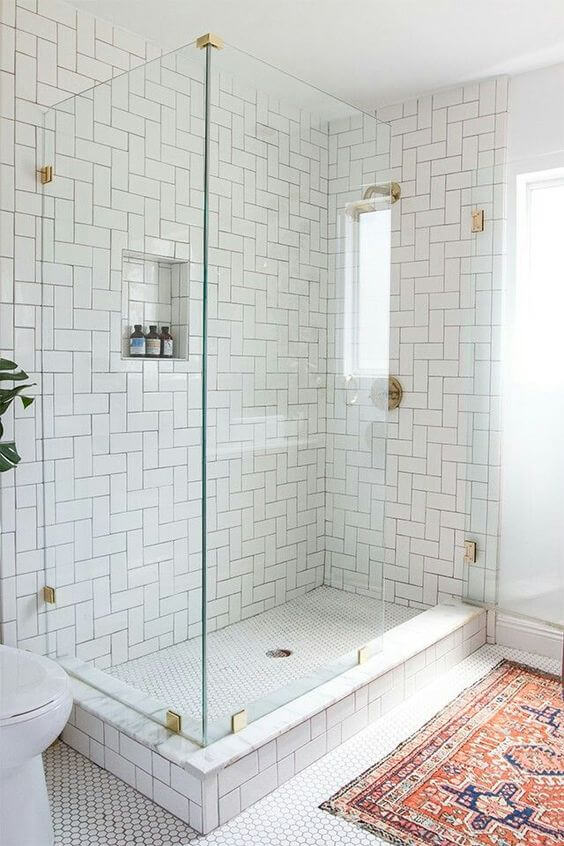 Shower Tile - Subway tile, slab, marble? We find that our clients always have a preference, it's just about being properly educated on the positive and negatives between the different materials.Pro tip: The smaller the tile the more grout there is to clean!Photo by Studio Interior Design