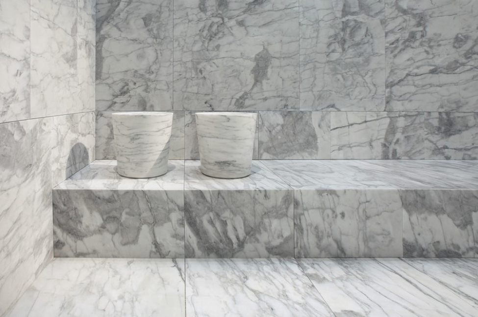 Carved sinks, made of Arabescato Statuario marble.