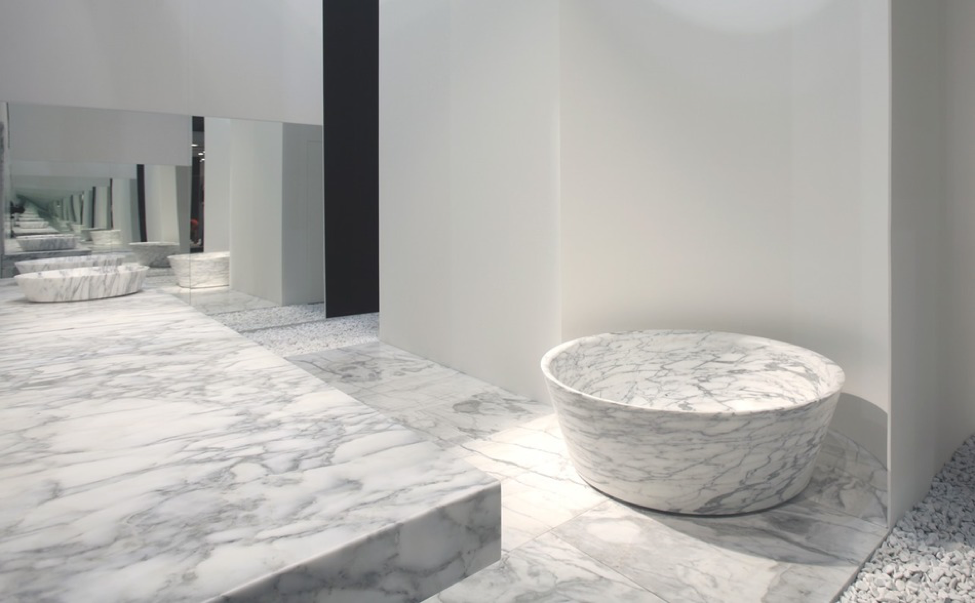 Carved stone bathtub, made of Arabescato Statuario marble.