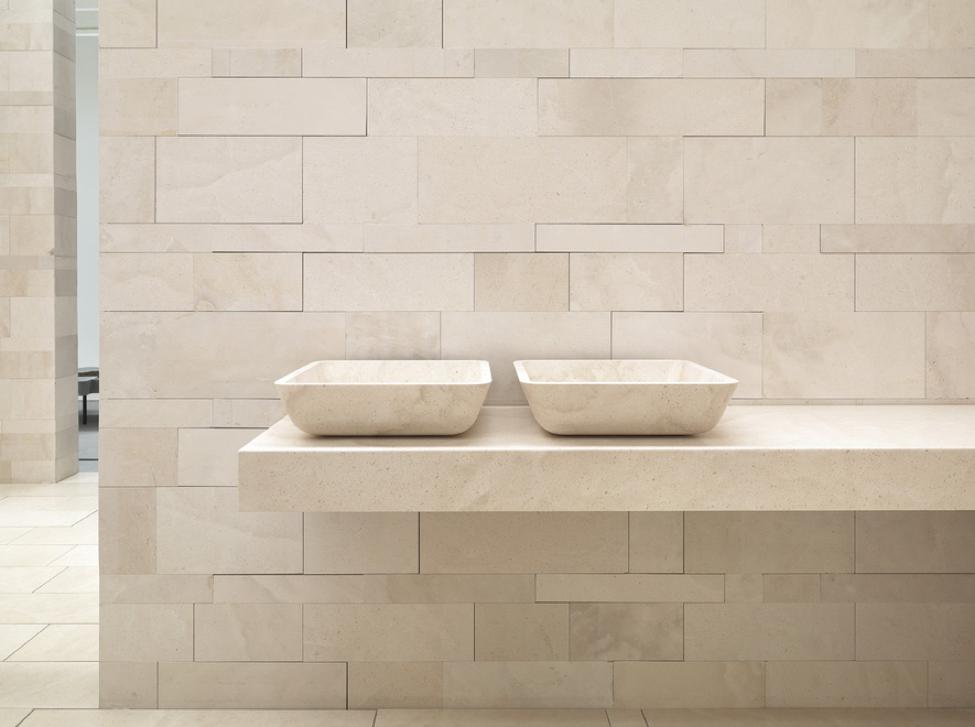 Carved stone shower pan made of Pietra di Brera stone.