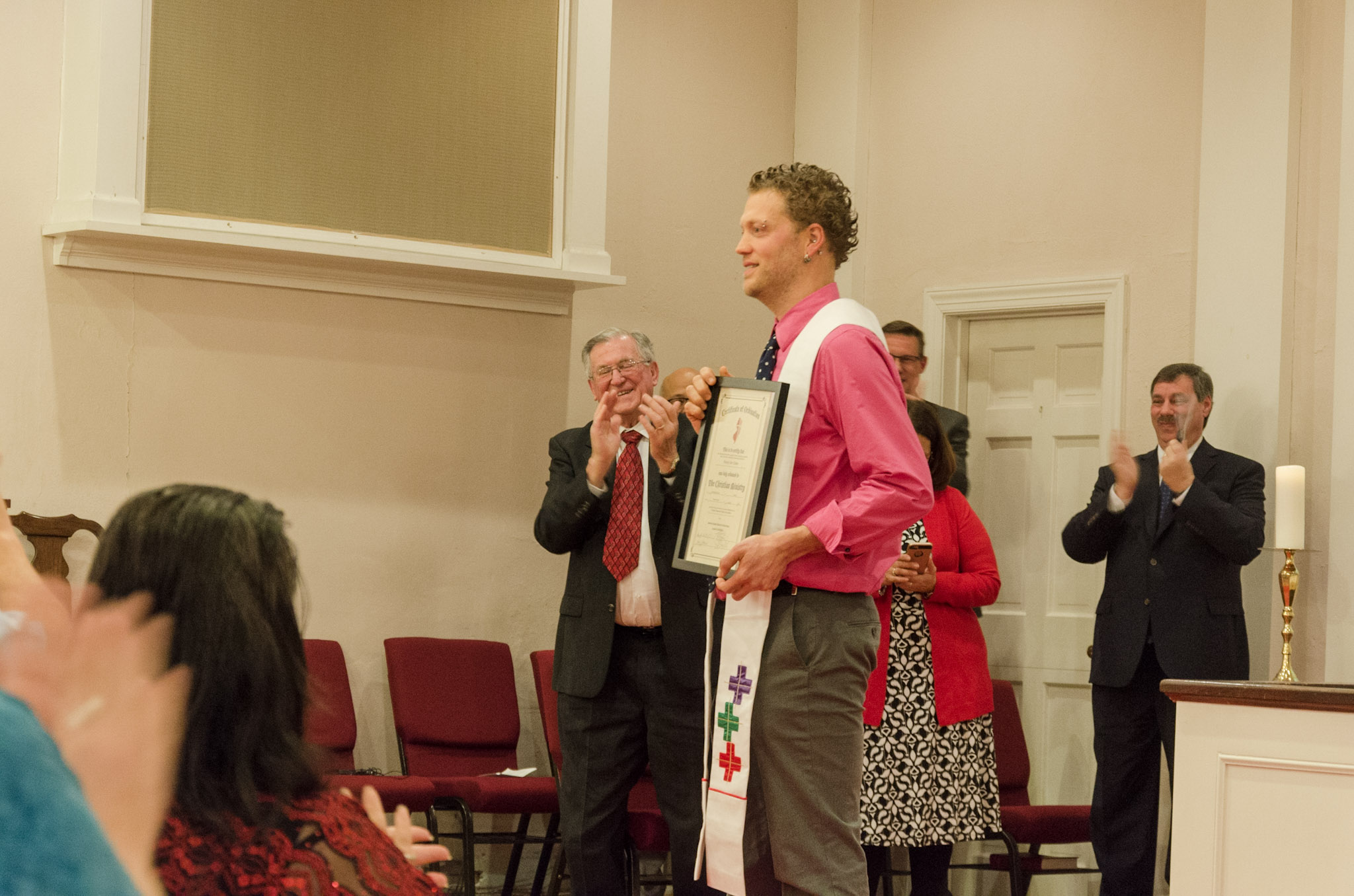 Randy receiving his ordination certificate