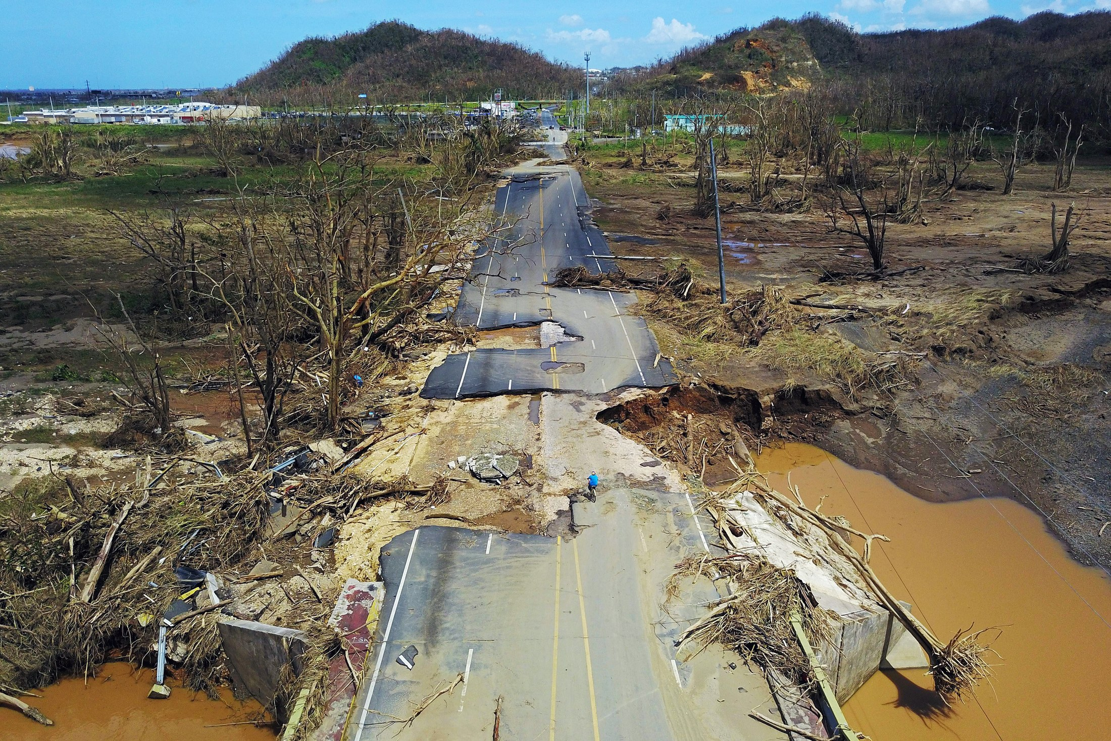 A damaged road in Toa Alta, west of San Juan. Photo by Ricardo Arduengo/AFP/Gerry Images