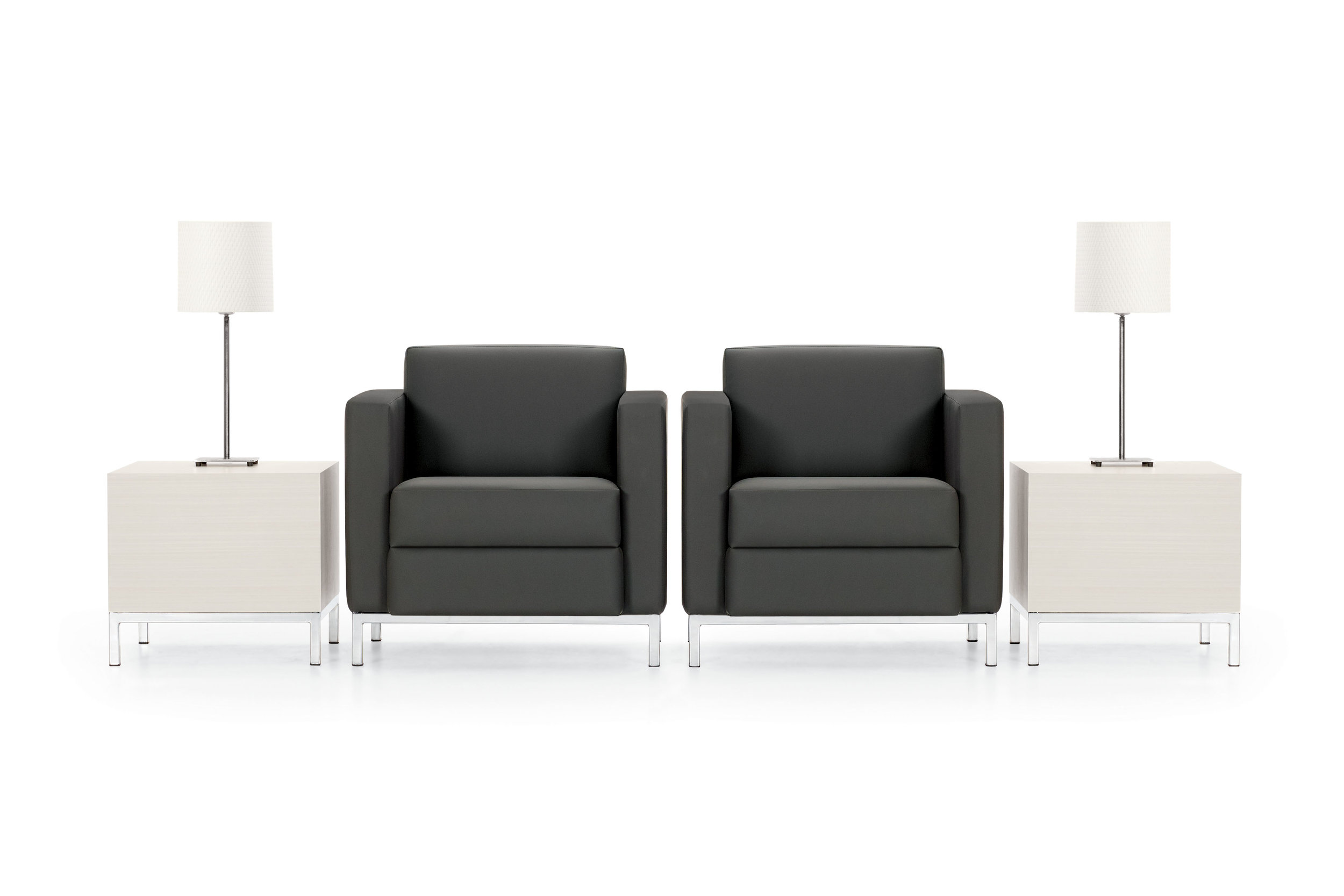 two office chairs with side tables