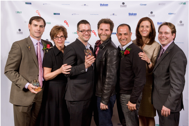 Team Rotary and Team Motion Source on the red carpet with their awards