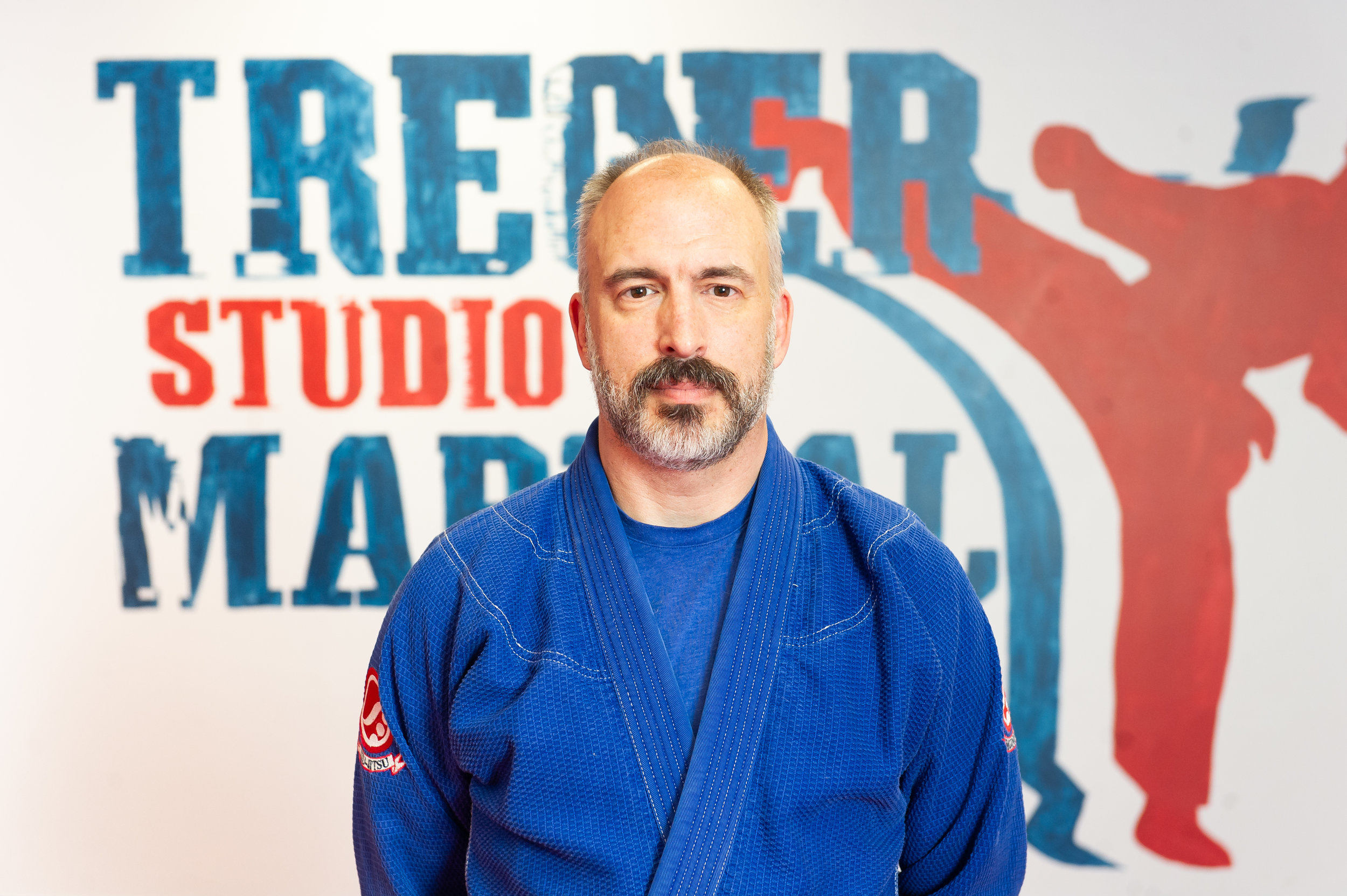 SENSEI TOM MACIAK Tom Maciak is one of our Brazilian Jiu Jitsu Instructors. Tom has been training BJJ since 2008 and is currently a Brown Belt under Steven Keckan. Tom received his BJJ instructor certification in 2010 under Professor Marcio Corletta, which emphasizes technical fundamentals and self-defense aspects of BJJ. Tom started marital arts in 1989 in Yoshinkan Aikido and has earned a black belt, plus a brown belt (1 kyu) in Budokan Kendo. He also competed in collegiate fencing (foil), and completed Michael Janich's Martial Blade Concepts System. He has been a Defensive Tactics Instructor, teaching weapons retention, handcuffing, hand to hand and PPCT. -