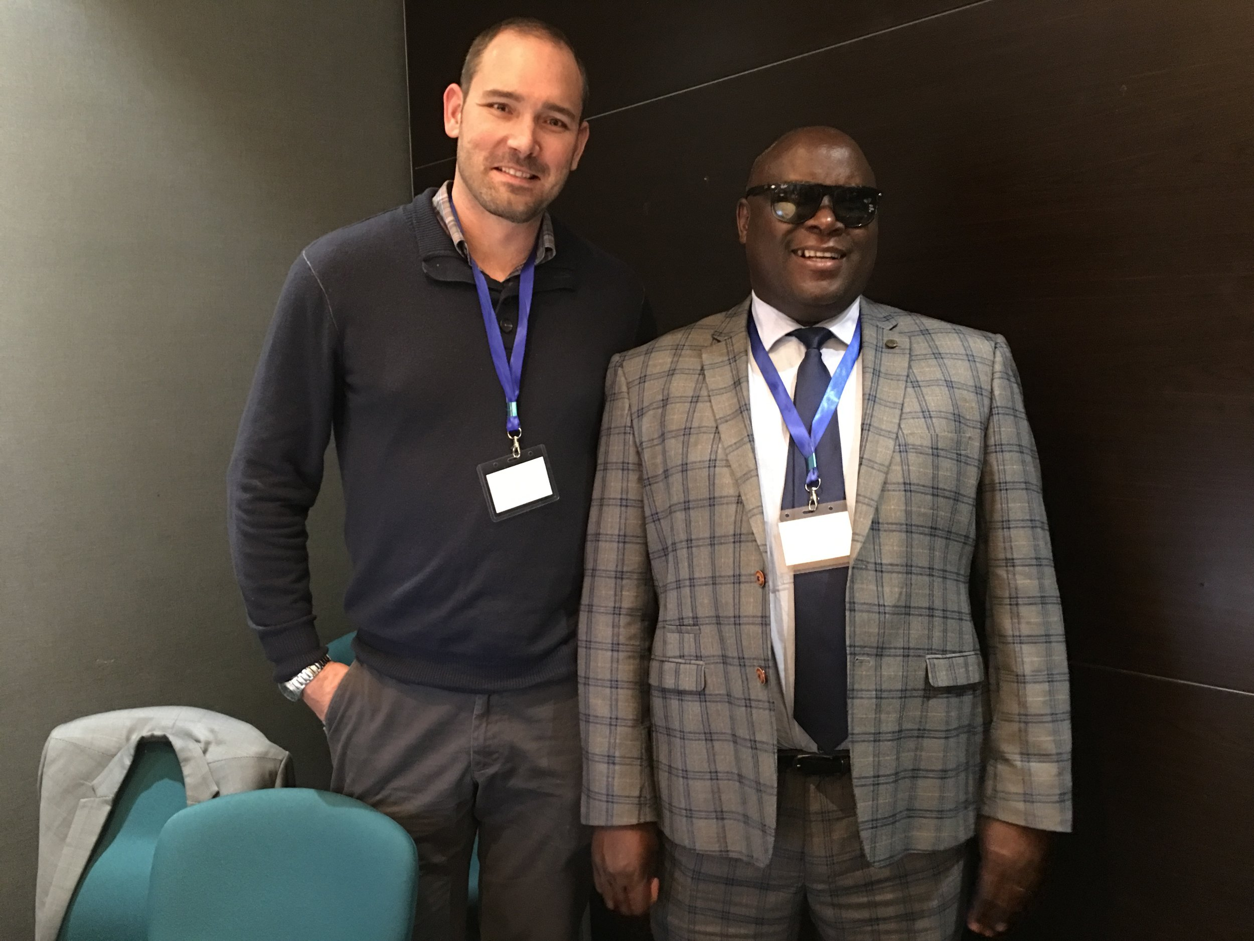 Brent Elder of Rowan University and Tangata Group (left) and Fred Haga, the KenyanDeputy Director in the Directorate of Special Needs Education (right) pose for a picture.
