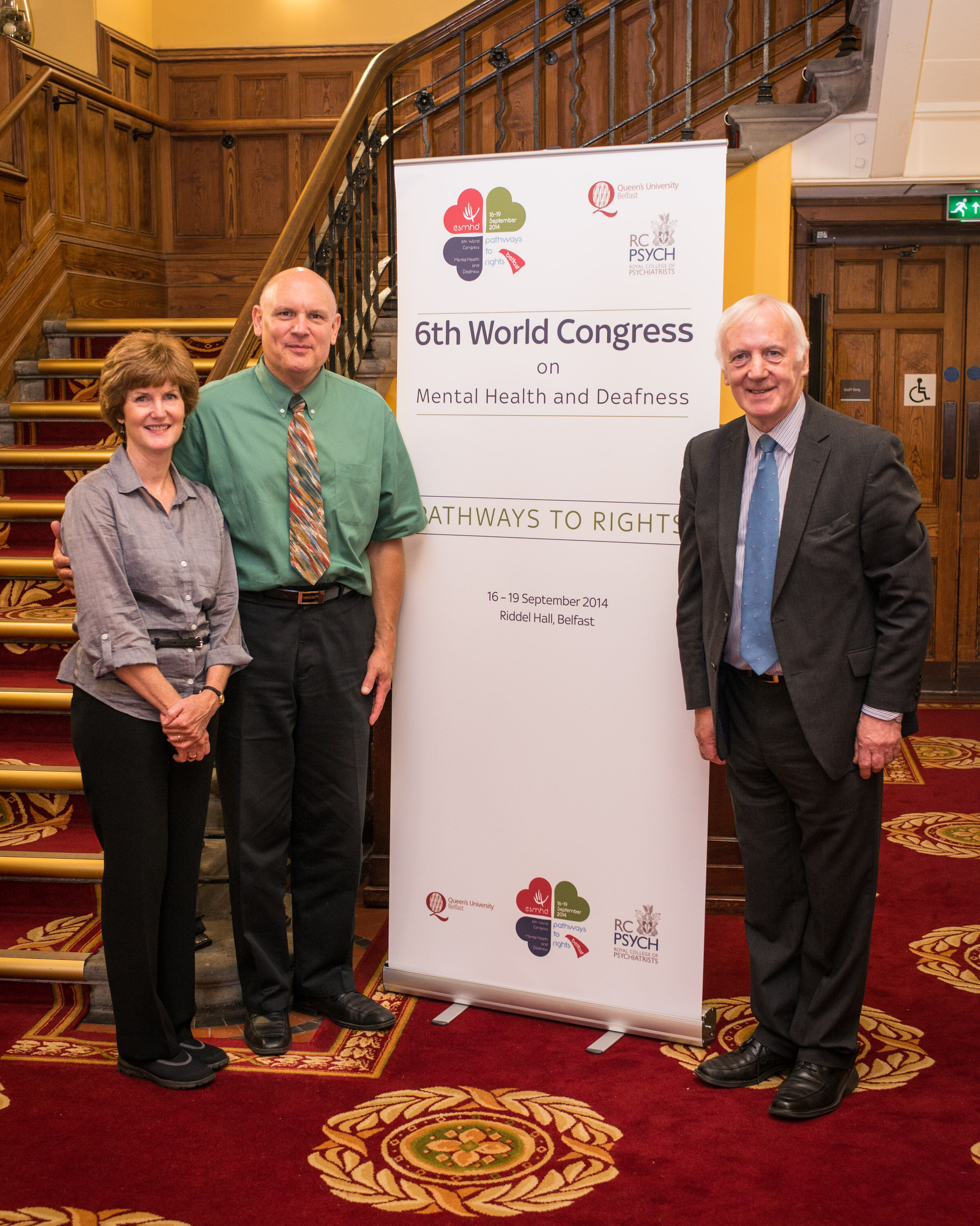 Michael Schwartz (Second from the left) with his wife, Trisha Schwartz (far left) and Brian Symington (right), a tireless advocate for the Deaf community in the UK at the Sixth World Congress on Mental Health and Deafness in Belfast, Northern Ireland, in October 2014.