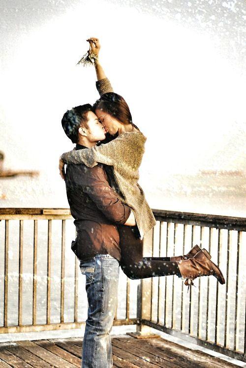 Couple kissing under Mistletoe.jpg
