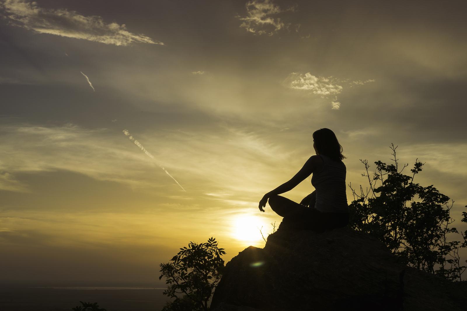 bigstock-Girl-Practicing-Yoga-On-The-Mo-239100070.jpg