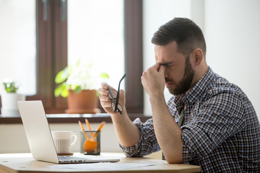 bigstock-Tired-Stressed-Male-Worker-Tak-241436326.jpg