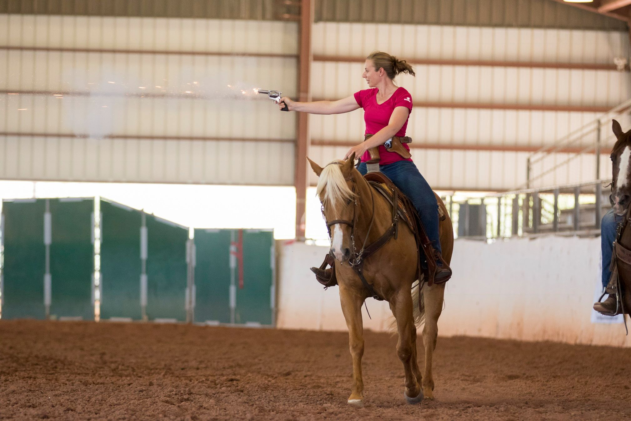 Katie Navarra participates in the mounted shooting demo at the 2017 AHP conference. (Photo by Vanessa Hughes / Lady Photographic)