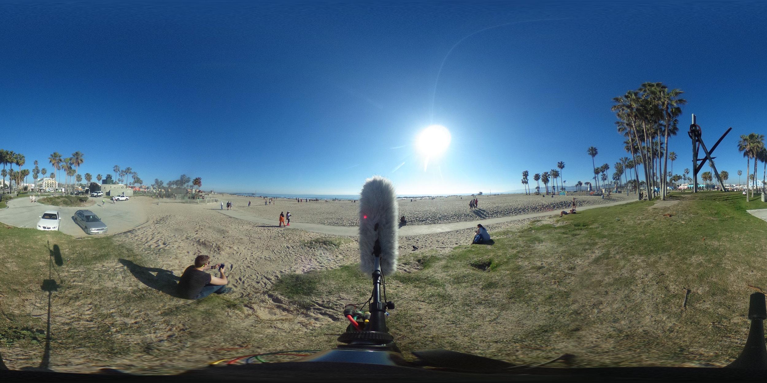 EXT_Day_Beach_Boardwalk_BikePath_ConstantSeaGulls_BicycleBys_PedestrianSlowBys_MediumToDistantPerformanceCrowd_DistantMusicSporadically_JPEG.JPG