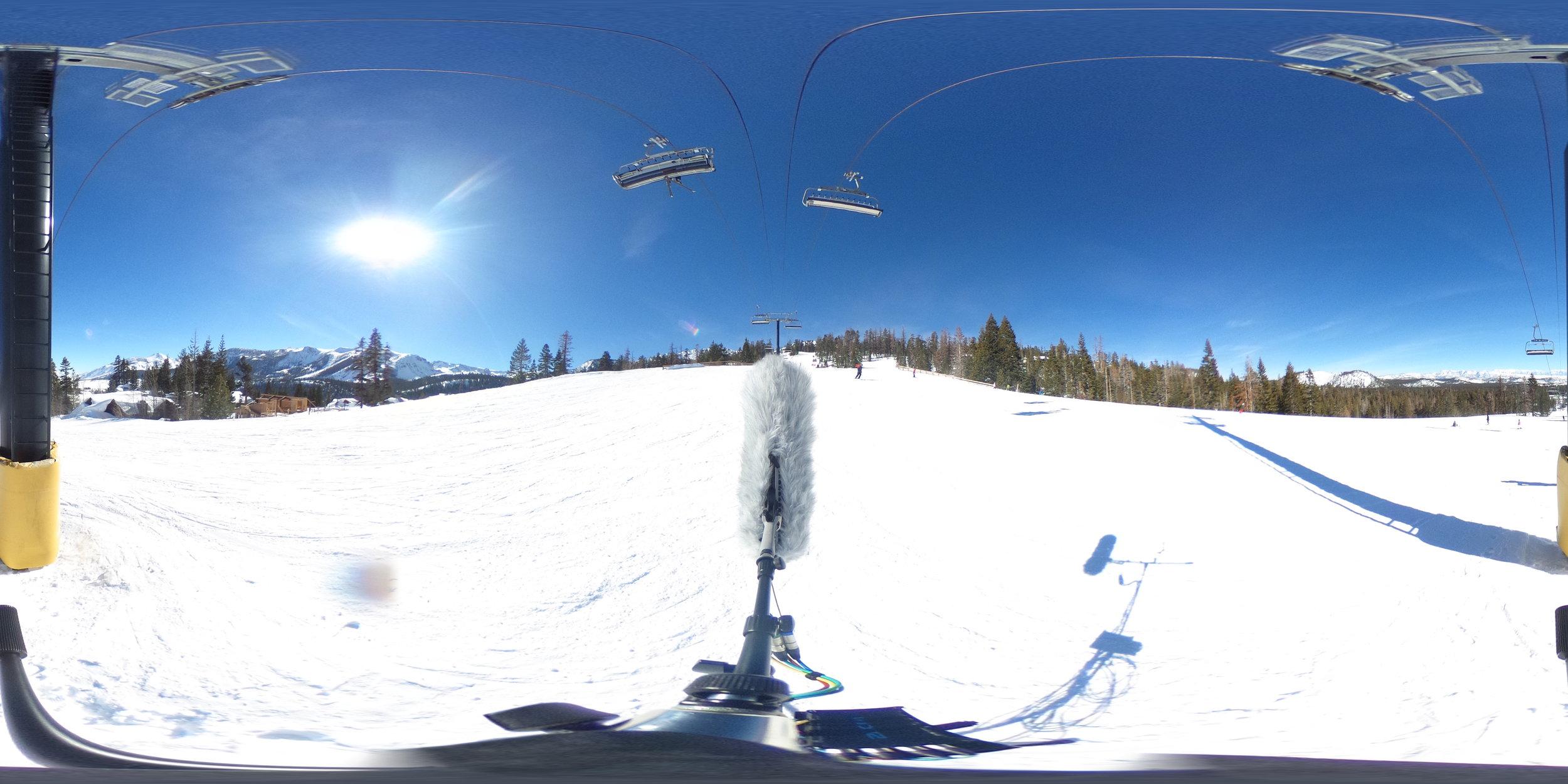 EXT_Day_SkiSlope_SkiLiftOverhead_SkiBys_SnowboardBys_VariousVoices_JPEG.JPG