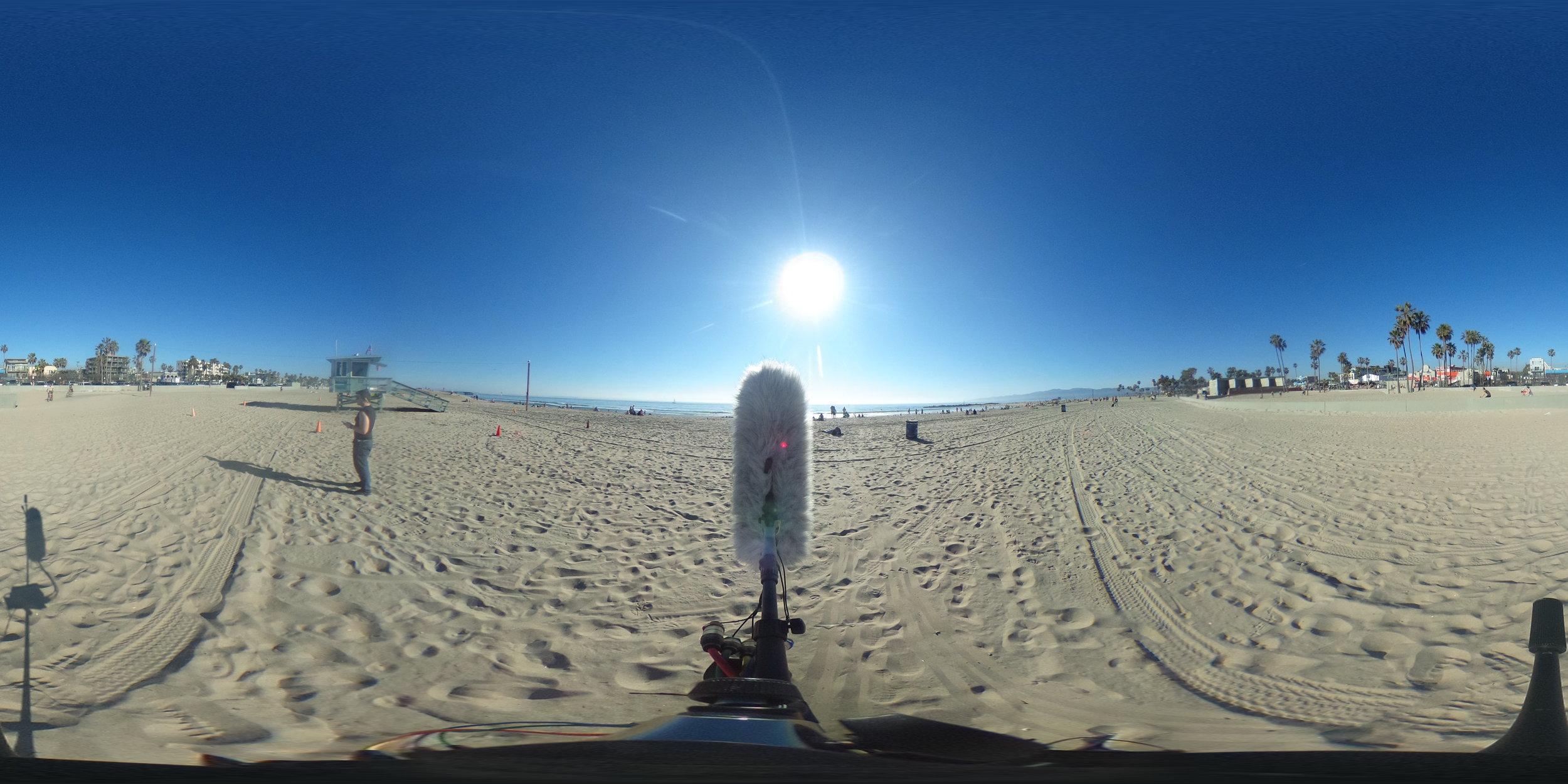 EXT_Day_Beach_ConstantDistantWaves_DistinctPlayfulVoices_BicycleBysWithBikeBell_HelicopterBys_DistantSeaGulls_JPEG.JPG