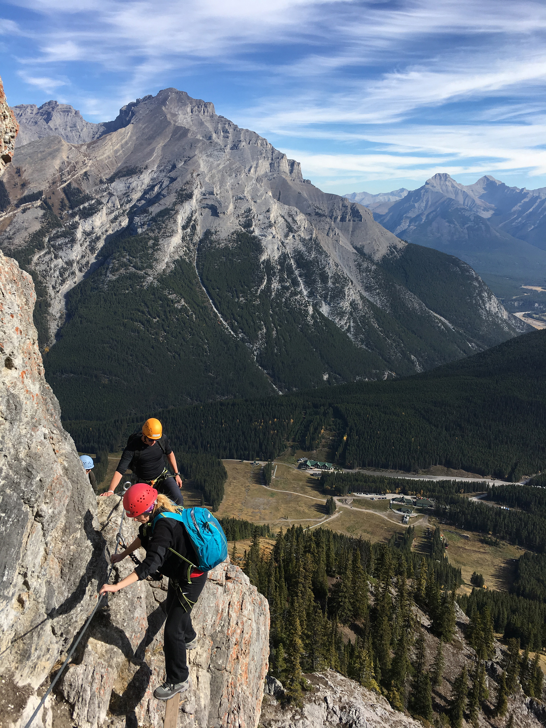 Finding footholds on the side of a mountain in Banff while traversing the Via Ferrata.