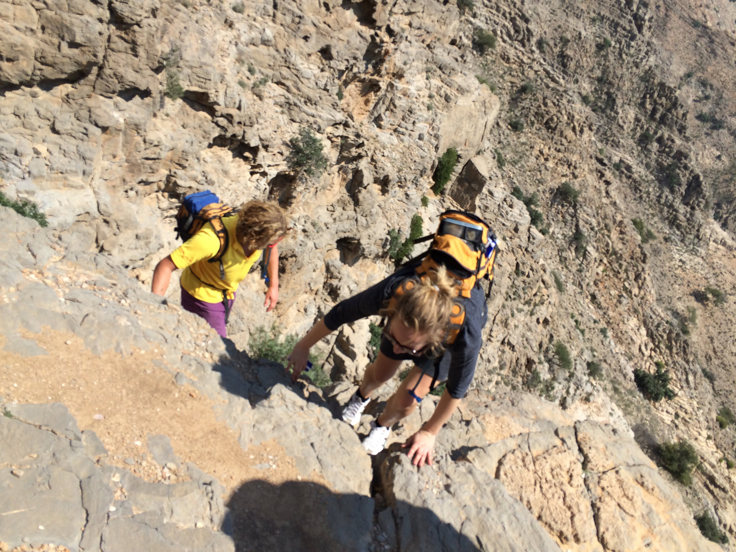 Hiking some steep sections in Aqaba in Oman while trekking with abosulute Adventure