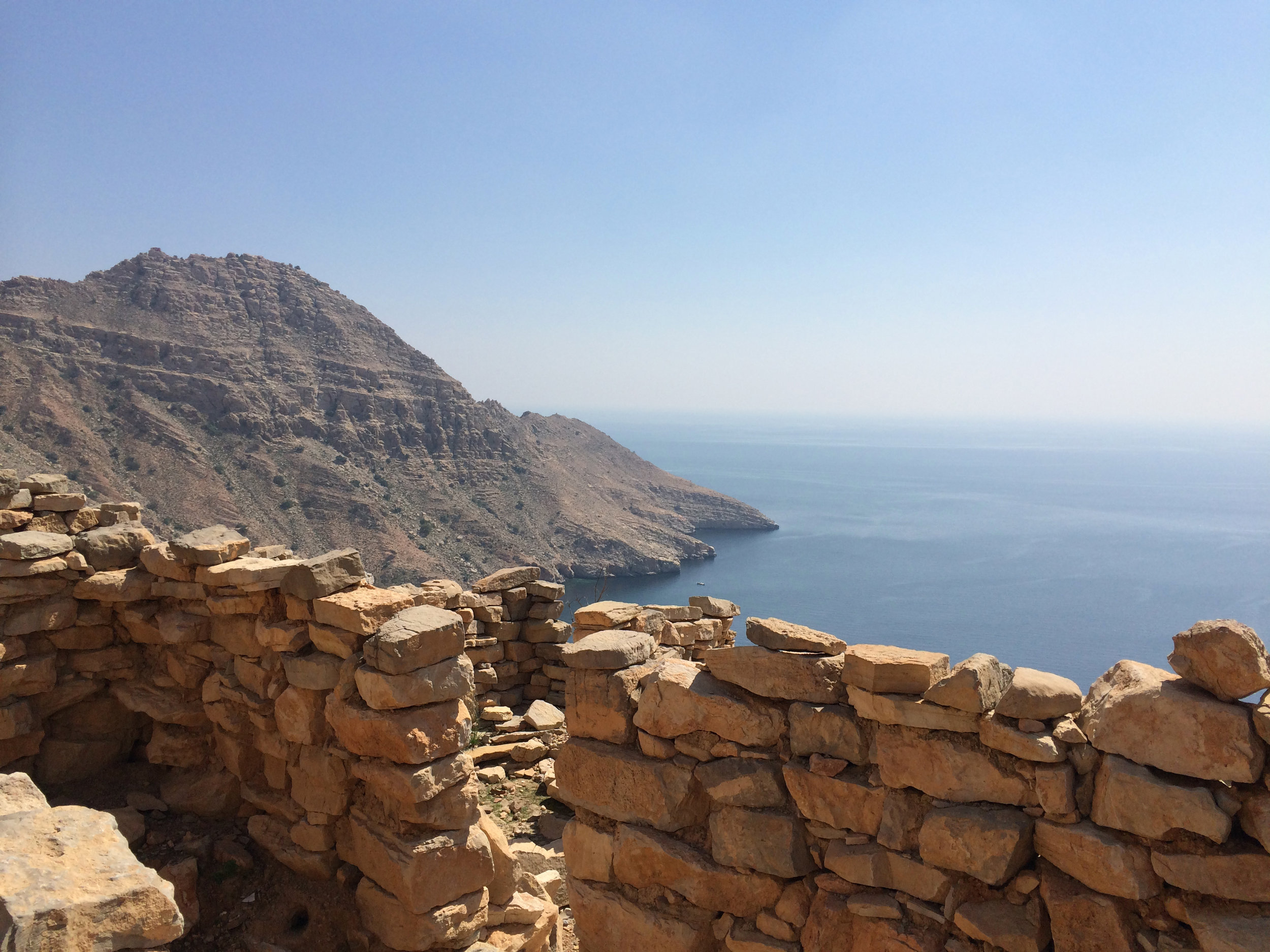 Ancient stone houses line the mountain top village in Aqaba, Oman