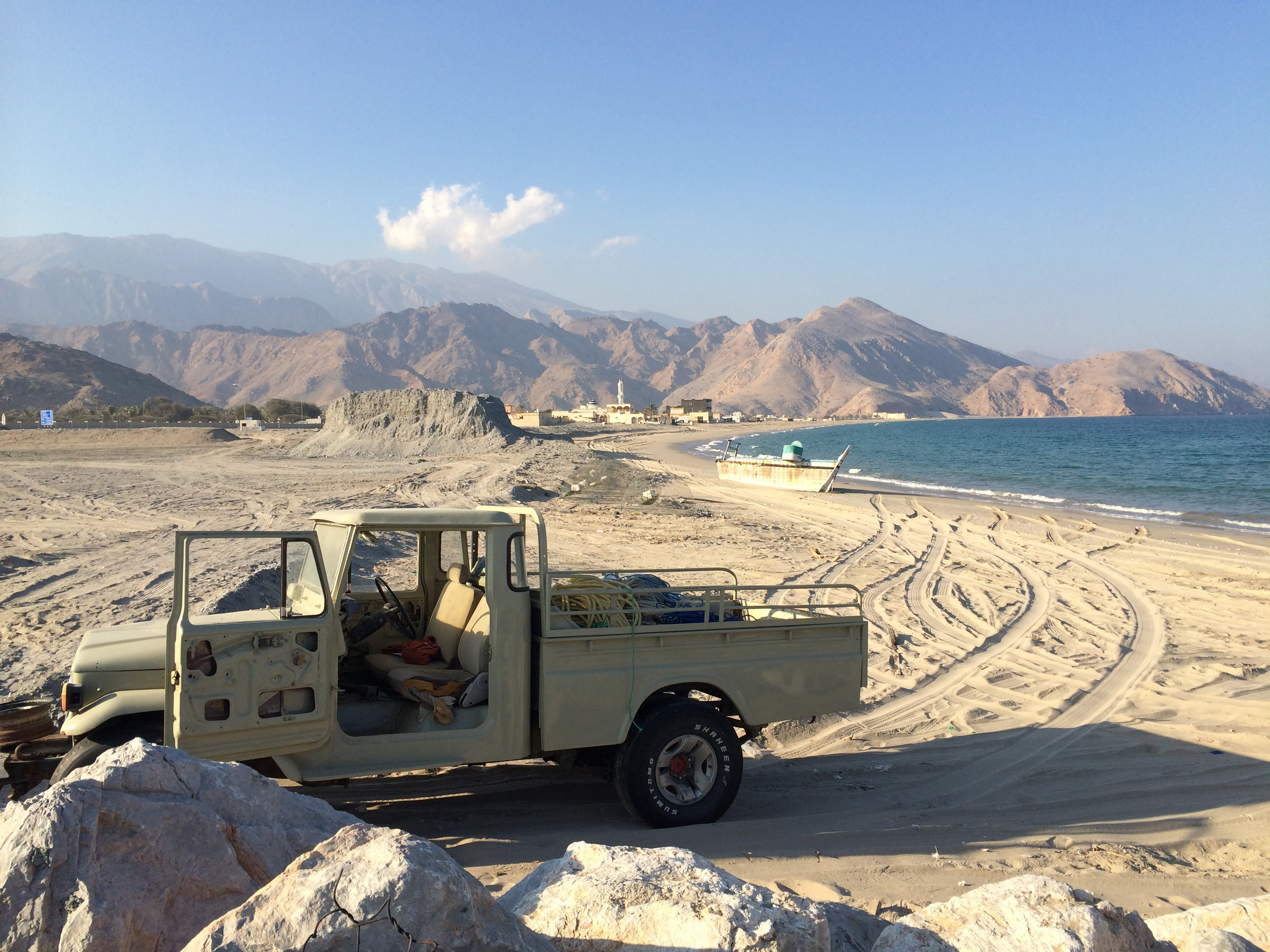 And old jeep sat abandoned on the beach in Lima, Oman