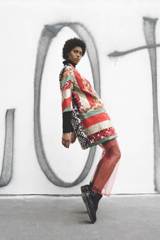 Coat: Llamazares y de Delgado  Trousers: New York Vintage Inc  Boots: Doc Martins