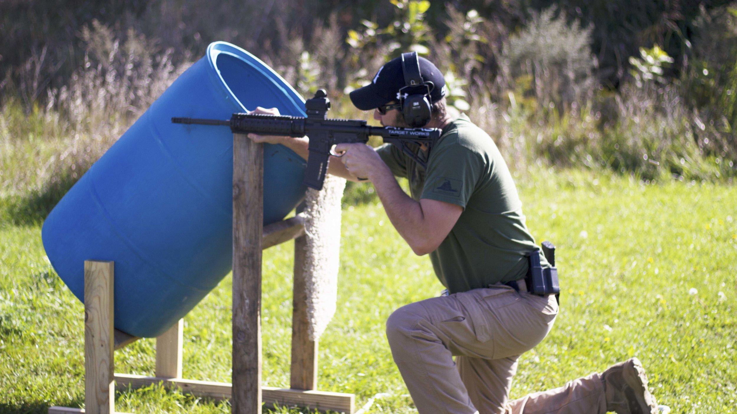 Brad Kneeling with Rifle.jpg