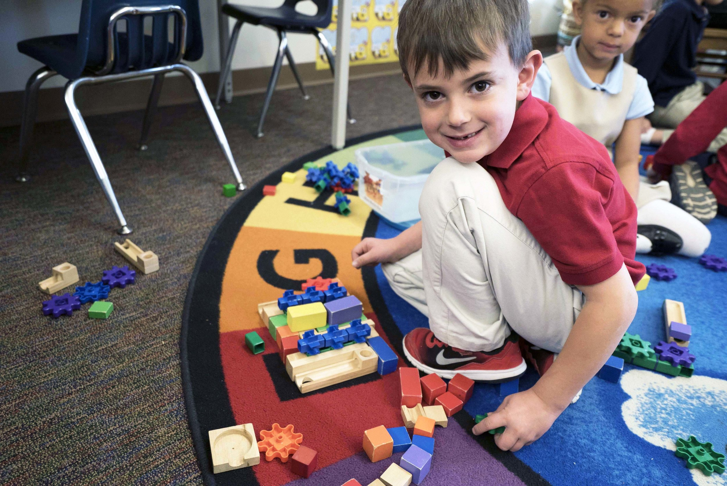 Student working with building blocks