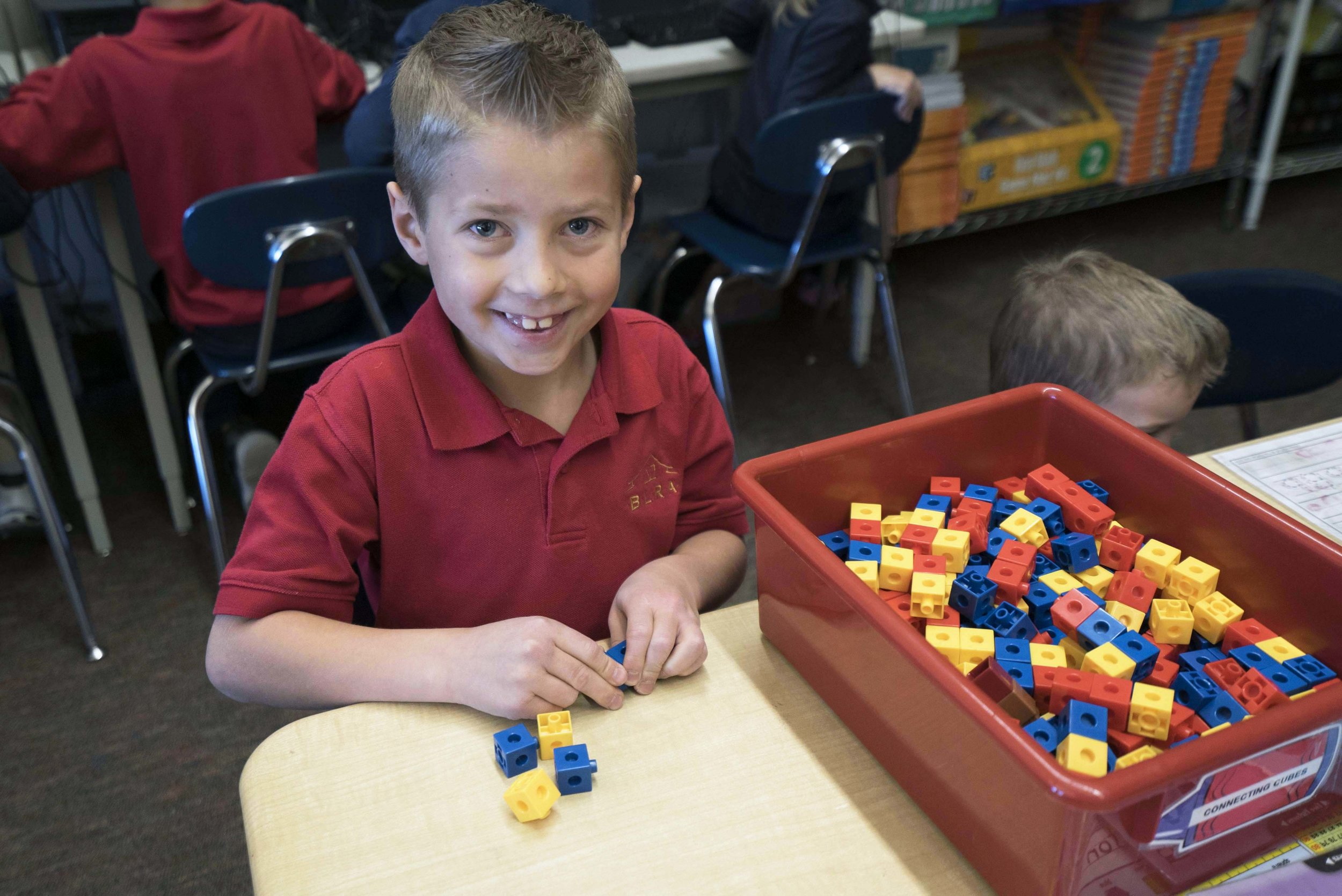 Student working with blocks