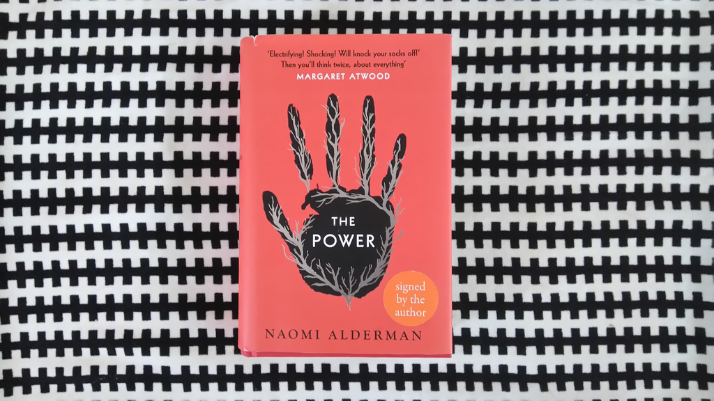The Power   by Naomi Alderman. A signed hardback with a small rip in the dustsheet, generously lent by a friend and not yet returned. Published in 2016 by Viking.