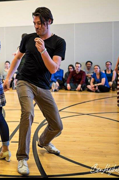 "Mark Carpenter - Originally from California, Mark has been effectively nomadic since 2010 and is excited to be back teaching across the US after a three month residency in San Francisco. Mark began dancing lindy & blues in 2005 and started teaching shortly thereafter, exploring various other dance styles from tango to contact improv along the way. In 2007 he co-founded the still-running Drop Dead Blues in SLO and has been part of the organizational staff for dozens of events including SLOx, SFF, and BluesQuake. In recent years he has dedicated his study to the emerging forms and conventions of ""fusion"" dance and is eager to explore and advance that movement through quality teaching throughout the world. Coming from a non-dance back­ground spanning theater, music, and tech, Mark has a unique approach to dance and its instruction. His constant goal is to make the impossible easy and the easy look impossible."