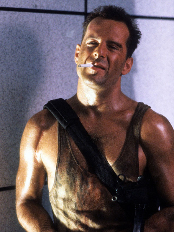 Bruce Willis as John McClane.